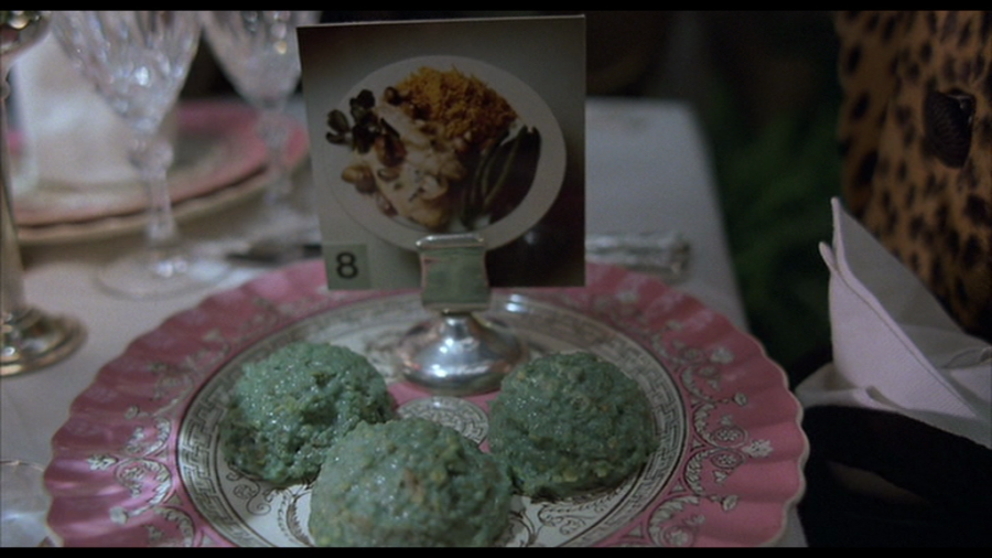 Dinner in Terry Gilliam's Brazil, where representations of tastiness must suffice, and where reality is far more bland.