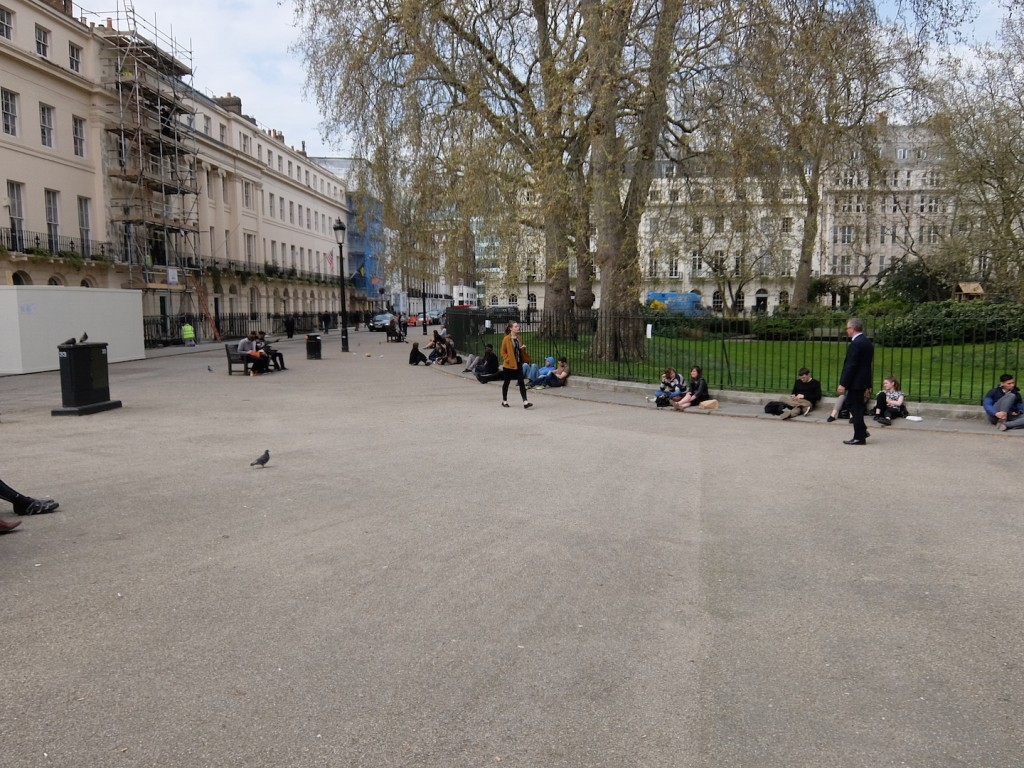 And here's how we do it in London. Three benches and a fence to keep you out of the green.