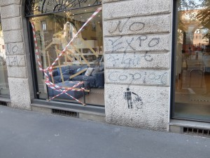 A vandalized shopfront in central Milan.